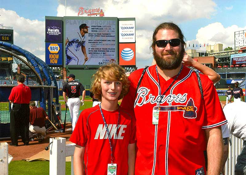 Eric Siegel attends Atlanta Braves batting practice with his son.