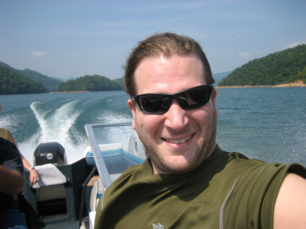 Eric Siegel drives a boat on Fontana Lake